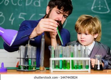Chemistry experiment. Cognitive process. Kids cognitive development. Mental process acquiring knowledge understanding through experience. Back to school. Cognitive skills. Teacher child test tubes.