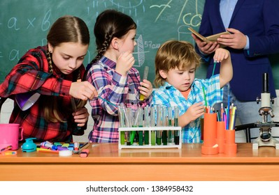 chemistry lab. back to school. happy children teacher. kids in lab coat learning chemistry in school laboratory. making experiment in lab or chemical cabinet. Testing blood samples.
