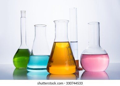 chemistry laboratory equipment, flasks and test tube with color reagents