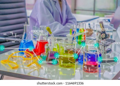 Chemists work lab in morning, With test pieces working with colorful liquid chemicals,Glass tubes, and chemical formula icons,For cosmetics,develop safe recipes for consumers.