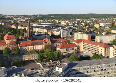 Chemnitz city in Germany (State of Saxony). Aerial view in warm sunset light.