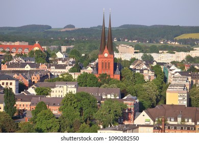 Chemnitz city in Germany (State of Saxony). Aerial view in warm sunset light of Sonnenberg district.
