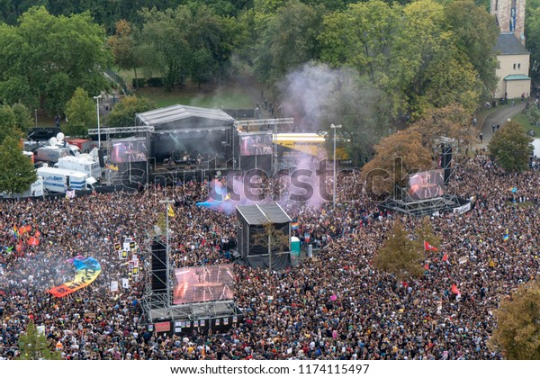 """CHEMNITZ, GERMANY – 09/03/2018: Crowd at a free concert of different bands. The charity concert is under the motto """"we are more"""". The concert is a reaction to recent riots by right-wing groups."""