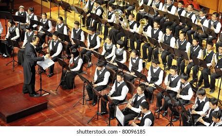 CHENGDU - APR 23: student symphonic band of High School No.7 Chengdu perform on concert on Apr 23,2011 in Chengdu,China.