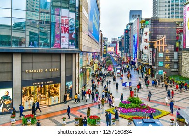 Chengdu, China - 9 December, 2018: Chun Xi Lu Road is the main shopping street in Chengdu.Lined with big and small name retail shops selling mostly street food ,clothes and accessories.