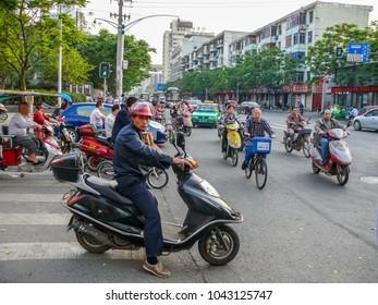 Chengdu, China - April 24, 2017: Chengdu city street, Chinese traffic jams at the crossroads, people on motobikes