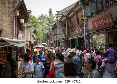 Chengdu, China - Aug 20, 2016. People at Jinli Ancient Street in Chengdu, Sichuan. Chengdu is one of the three most populous cities in Western China (the other two are Chongqing and Xian).