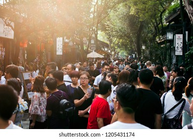 Chengdu / China  - August 2nd 2018. Crowds at Famous Tourist Sight in Chengdu Street Alley Way with Old Traditional Buildings, Many People.