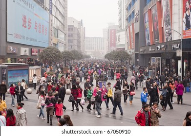 CHENGDU, CHINA - DEC 12: people strolling in Chengdu on Dec 12, 2010. China's retail sales of consumer goods grew 18.7% in November year on year, the National Bureau of Statistics (NBS) reports.