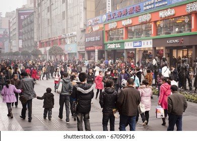 CHENGDU, CHINA - DEC 12: people strolling in Chengdu on Dec 12, 2010. China's retail sales of consumer goods grew 18.7% in November year on year, the National Bureau of Statistics (NBS) reports. .