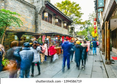 Chengdu, China - December 9, 2018: Shopper and stores at Jinli Ancient commercial street is one of the most famous tourism in Chengdu old street of China where full of retro Chinese