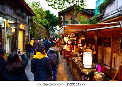 Chengdu, China - December 9, 2018: Street food shop at Wide and Narrow Alley (Kuanzhai Xiangzi) Ancient commercial street is one of the most famous tourism in Chengdu old street of China where full of