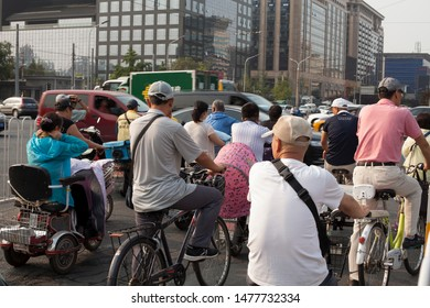 Chengdu, China, July 1, 2019: people going to work on bicycles in Chengdu, China. July 1, 2019 in Chengdu, China.