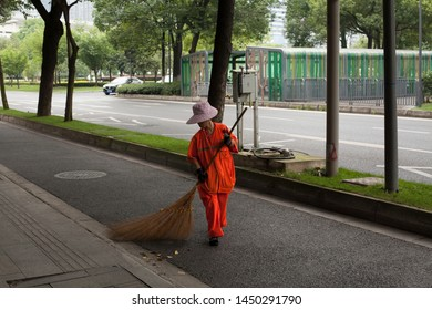 Chengdu, China, July 2, 2019: street sweeper in   Chengdu, Sichuan, China. July 2, 2019 in Chengdu, China