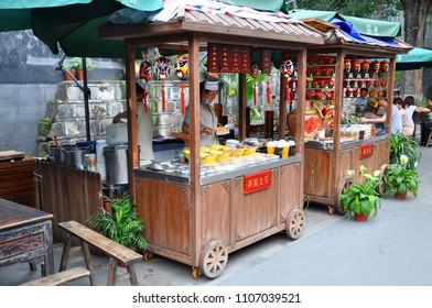 CHENGDU, CHINA - JUN.22, 2012: Vending Cart in Kuan Alley and Zhai Alley Wide and Narrow Alley in old city of Chengdu, Sichuan Province, China.