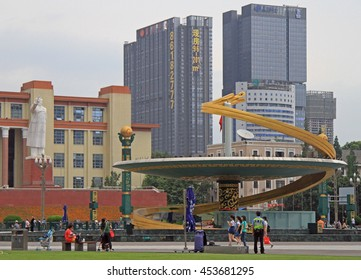 CHENGDU, CHINA - JUNE 14, 2015: people are walking by square in front of Sichuan Science and Technology Museum in Chengdu, China