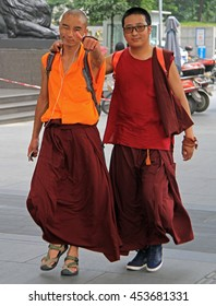 CHENGDU, CHINA - JUNE 16, 2015: two chinese monks are walking by streets in Chengdu, China