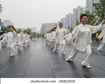 CHENGDU, CHINA - JUNE 4, 2012: Unidentified people practicing tai chi on the street of Chengdu, China. In China, tai chi  is categorized under the Wudang grouping of Chinese martial arts.