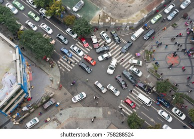 Chengdu, China - March 17, 2017 : Heavy traffic in a small streets crossroads vertical view