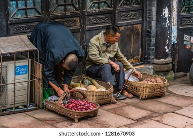 CHENGDU, CHINA - OCTOBER 02: Street photography scene of locals selling fruit and vegetables at Luodai Ancient Town on October 02, 2018 in Chengdu