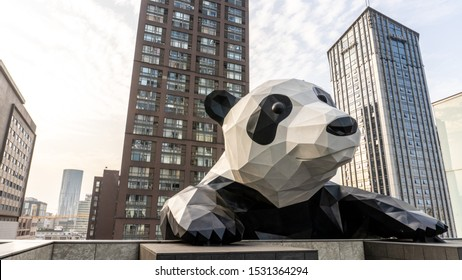 CHENGDU, CHINA - OCTOBER 11, 2019 - A climbing giant panda at Chengdu International Finance Square (IFS), the famous shopping mall in downtown Chengdu. View from the rooftop.