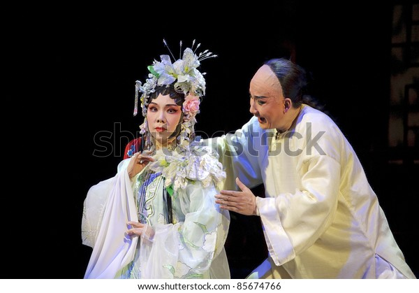 CHENGDU - JUN 3: Chinese Cantonese opera performer make a show on stage to compete for awards in 25th Chinese Drama Plum Blossom Award competition at Jinsha theater.Jun 3, 2011 in Chengdu, China.