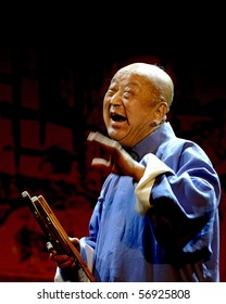 """CHENGDU - MAY 23: The chinese Rap music show """"JINQIANBAN"""" performed by the famous blind artist Zou Zhongxin(He is eighty seven years old now.) at Golden theater.May 23, 2007 in Chengdu, China."""