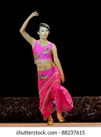 CHENGDU - SEP 28: chinese Dai ethnic dancer performing on stage in the 6th Sichuan minority nationality culture festival at JINJIANG theater.Sep 28,2010 in Chengdu, China.