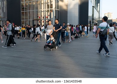 Chengdu, Sichuan / China - April 01 2019: Consumers walking by the luxury shopping district Tai Gu Li. Chengdu is the most developed city in South China and starting point of silk road.