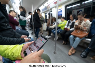 Chengdu, Sichuan / China - February 01 2019: Chinese using smart phone in Chengdu, the largest city in South West China. Huawei is the most popular brand than Apple and Samsung.