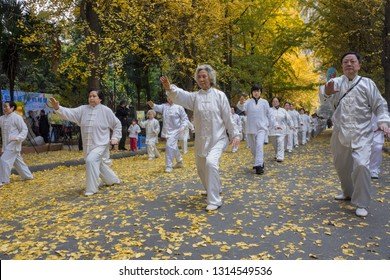 Chengdu, Sichuan / China - February 02 2019: a group of elders doing tai-chi on a street in Chengdu. Tai Chi is very popular in China.