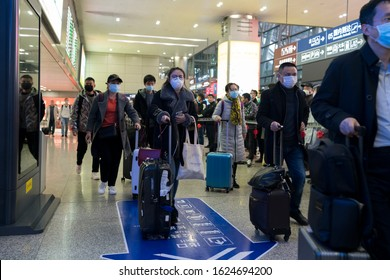 Chengdu, Sichuan / China - January 23 2019: travellers all wear mask at airport to prevent infection from coronavirus. The virus has caused emergency situation during Chinese New Year.