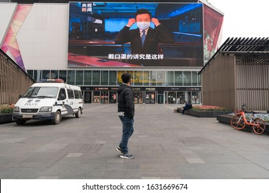 Chengdu, Sichuan / China - January 30, 2019: a screen at shopping district showing the broadcaster wearing a mask to host a news show regarding coronavirus.