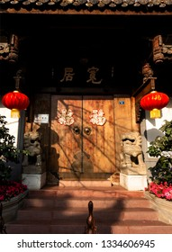 Chengdu, Sichuan / China - March 01 2019: a famous house in Kuan Zhai Xiang Zi with lanterns and traditional Chinese header, which is the most famous culture street in Chengdu.