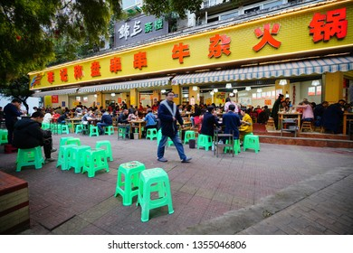 Chengdu, Sichuan / China - March 01 2019: small food stand on street of Chengdu downtown. Chengdu is famous for its delicious Sichuan Food. Food stands support mobile payment from Alibaba.