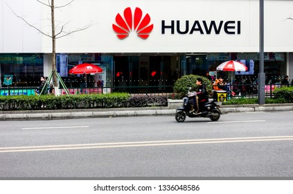 Chengdu, Sichuan / China - March 04 2019: people passing by Huawei retail store in Chengdu downtown. Huawei is now more popular than Apple and Samsung amid trade war and protest from US.