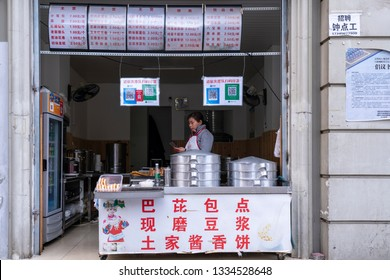 Chengdu, Sichuan / China - March 05 2019:  Street food is very popular in Sichuan, especially those spicy dishes. Most of the restaurants and food stands accept mobile payment such as Ali Pay.