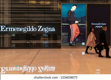 Chengdu, Sichuan / China - March 07 2019: Consumers passing by luxury retail stores in Chengdu downtown shopping center IFS. China is the largest luxury goods consumption country in the world.