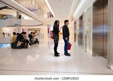 Chengdu, Sichuan / China - March 07 2019: Consumers waiting elevators in Chengdu downtown luxury shopping center IFS. China is the largest luxury good consumption country in the world.