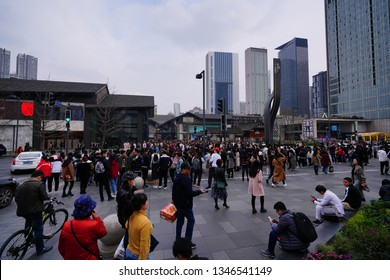 Chengdu, Sichuan / China - March 10 2019: People passing by retail stores in luxury shopping district Tai Gu Li and Chengdu IFS. China has become the largest luxury goods consumption country.