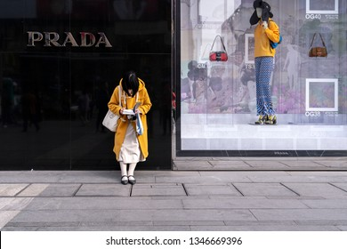 Chengdu, Sichuan / China - March 10 2019: consumers walking by luxury retail stores in Tai Gu Li and Chengdu IFS shopping district. China has become the largest luxury goods consumption nation.