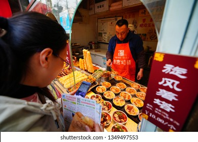 Chengdu, Sichuan / China - March 21 2019: Traditional Sichuan Street Food stands seen in an ancient town district in Chengdu. Sichuan food is famous for its spicy and tasty sauce.