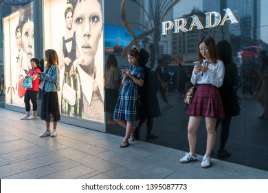 Chengdu, Sichuan / China - May 10 2019: consumers in Chengdu IFS shopping district. Most stores equip mobile payment. Chengdu is the most developed city in south China.
