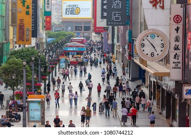 Chengdu, Sichuan Province, China - April 18, 2018: People on the famous pedestrianized shopping street Chunxi road in Chengdu, the capital of Sichuan Province in China.