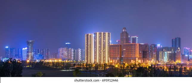 Chengdu, Sichuan Province, China - Aug 12, 2017: City south high-tec area skyline panorama with skyscrapers illuminated at night.