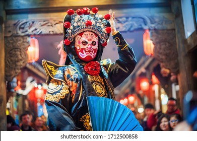 Chengdu, Sichuan Province, China - Jan 29, 2015: Chinese actor performs a public traditional face-changing art or bianlian onstage at Chunxifang Chunxilu covered street.