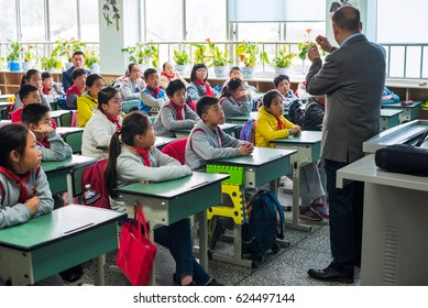 Chengdu, Sichuan province, China - March 31, 2017: Children and teacher in a chinese classroom