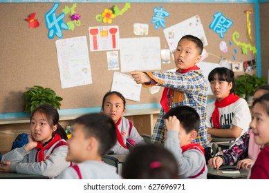 Chengdu, Sichuan Province, China - March 31, 2017: Schoolboy pointing his finger in a chinese school