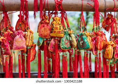 Chengdu, Sichuan province, China - Nov 29, 2015: Red lucky gift bags hanging on trees in Jinli public park