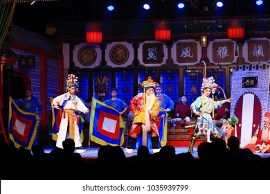 """CHENGDU,China November 2,2017: Actors of the Sichuan Opera Troupe perform the famous """"changing faces show"""" at the Culture Park Theater"""
